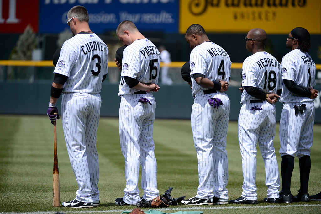 . DENVER, CO. - APRIL 21: Colorado Rockies Michael Cuddyer (3) Jordan Pacheco (15) Chris Nelson (4) Jonathan Herrera (18) and Eric Young Jr. (1) stand for the national anthem prior to their game against the Arizona DiamondBacks April 21, 2013 at Coors Field. (Photo By John Leyba/The Denver Post)