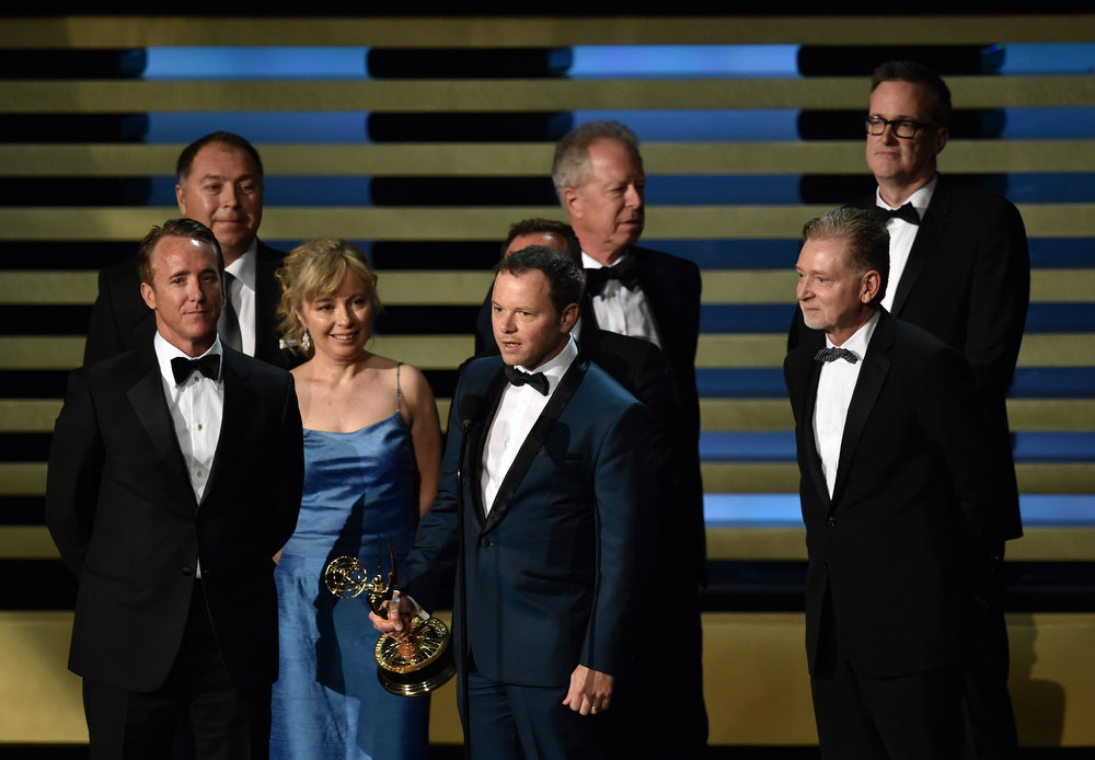 """. (L-R) Executive Producer Geyer Kosinski, Producers Michael Frislev, Kim Todd, Show Creator/Executive Producer Noah Hawley, Director Colin Bucksey, Executive Producer Warren Littlefield and Producer John Cameron, accept the Outstanding Miniseries Award for \""""Fargo\"""" during the 66th Annual Primetime Emmy Awards held at Nokia Theatre L.A. Live on August 25, 2014 in Los Angeles, California.  (Photo by Kevin Winter/Getty Images)"""