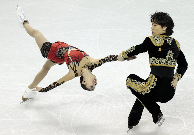 . Qing Pang and Jian Tong of China skate their short program in the pairs competition at the 2013 World Figure Skating Championships in London, Ontario, March 13, 2013.   GEOFF ROBINS/AFP/Getty Images
