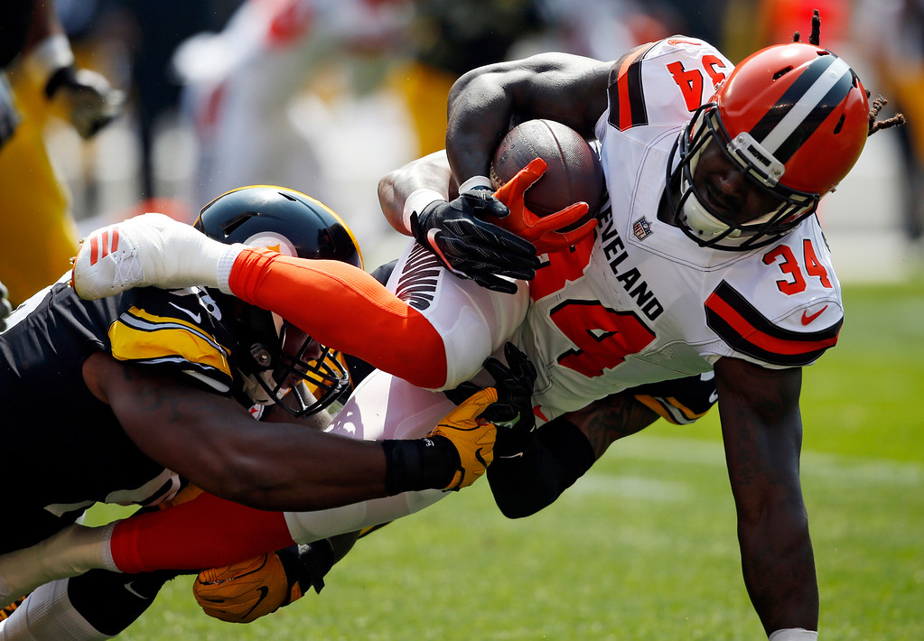 . Pittsburgh Steelers defensive end L.T. Walton, left, tackles Cleveland Browns running back Isaiah Crowell (34) during the first half of an NFL football game, Sunday, Sept. 10, 2017, in Cleveland. (AP Photo/Ron Schwane)