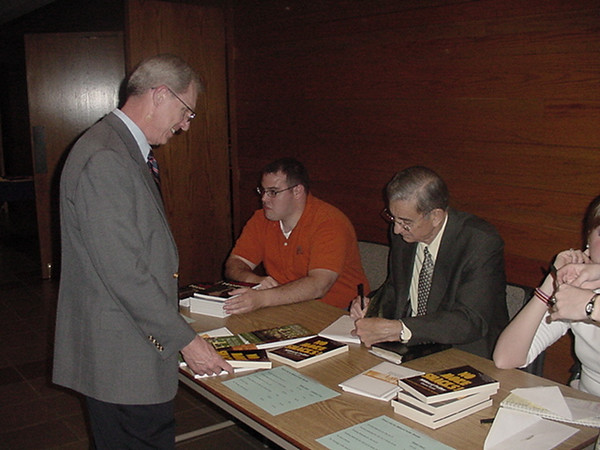 05 04-04 Autographing books in Abilene, TX.