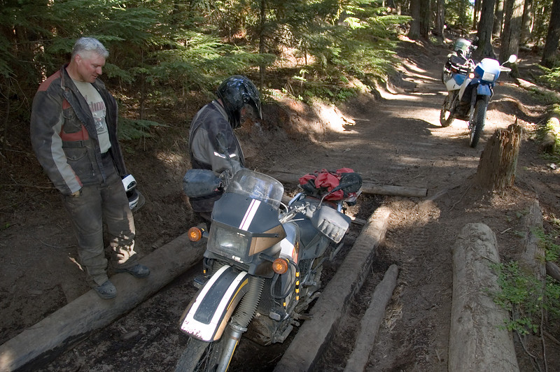 Scott prepares to ride his KLR out of the hole.