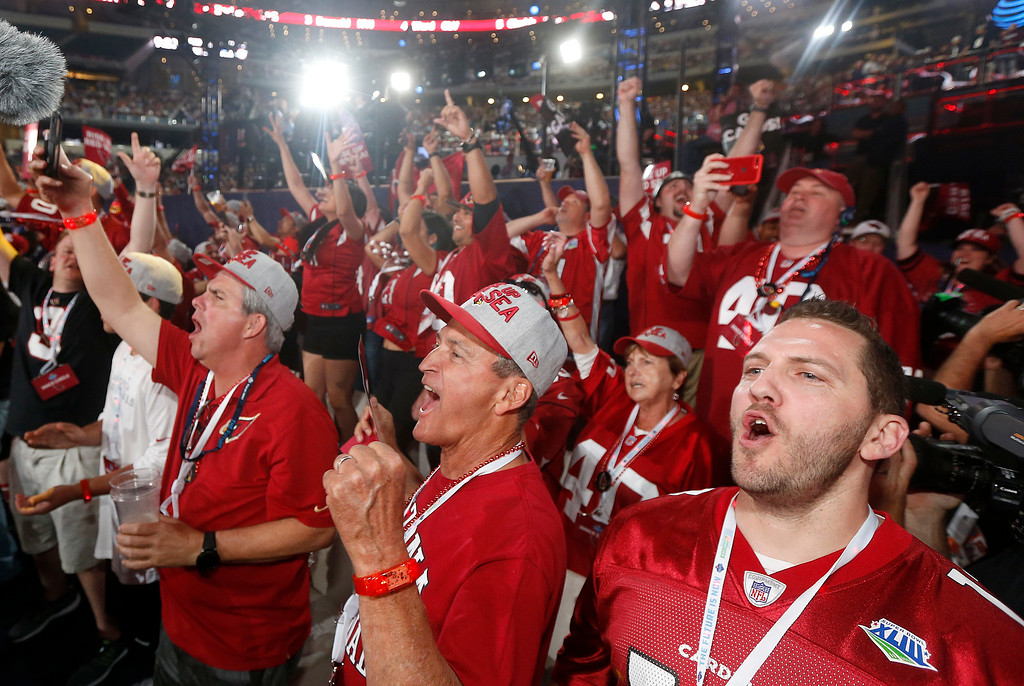 . Arizona Cardinals fans cheer the selection of UCLA\'s Josh Rosen during the first round of the NFL football draft, Thursday, April 26, 2018, in Arlington, Texas. (AP Photo/Michael Ainsworth)