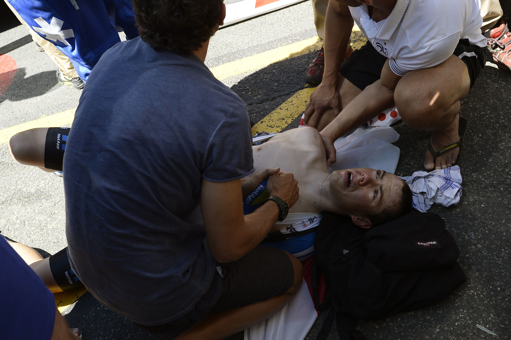 . Spain\'s David de la Cruz Melgarejo receives medical assistance after a fall during the 185.5 km twelfth stage of the 101st edition of the Tour de France cycling race on July 17, 2014 between Bourg-en-Bresse and Saint-Etienne, central eastern France.  (LIONEL BONAVENTURE/AFP/Getty Images)