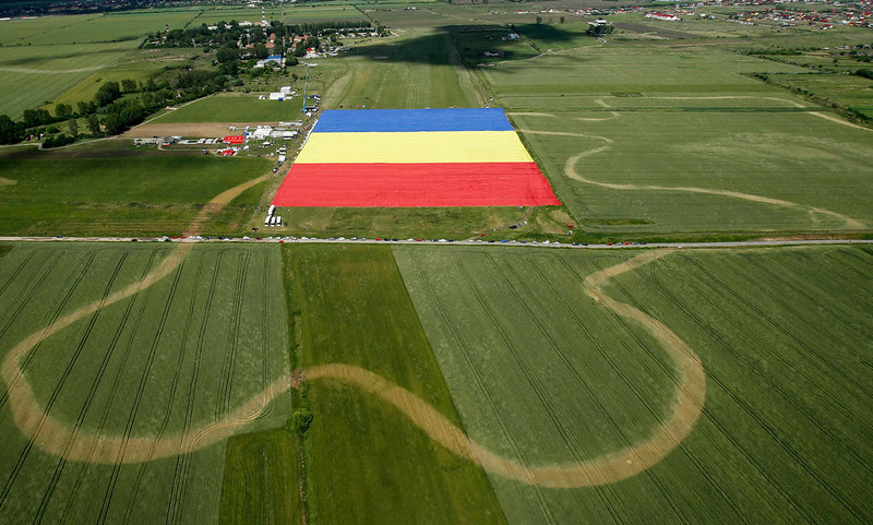 . An aerial picture shows a huge Romanian flag on the Clinceni Airfield, south of Bucharest, Romania, Monday, May 27, 2013. Romania entered the Guinness Book of records after it unveiled the largest flag ever made. It took about 200 people several hours Monday to unfurl a five-ton flag of Romania which organizers said measured 349.4 meters by 226.9 meters, about three times the size of a football pitch.(AP Photo/Bogdan Cristel, Pool)