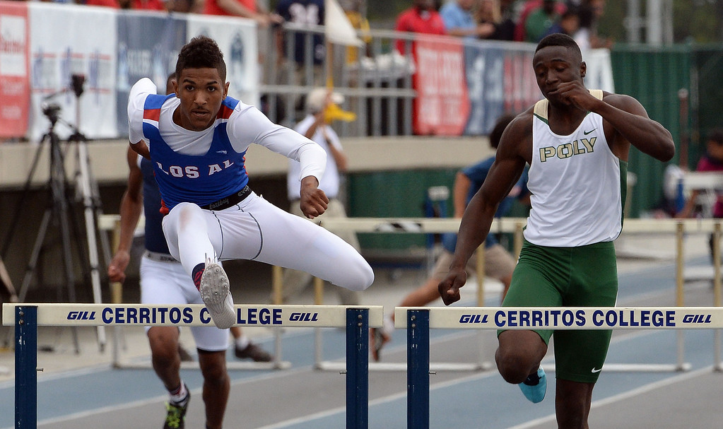 . Los Alamitos\' Tyler Rios wins the division 1 300 meter Intermediate hurdles during the CIF Southern Section track and final Championships at Cerritos College in Norwalk, Calif., Saturday, May 24, 2014.   (Keith Birmingham/Pasadena Star-News)