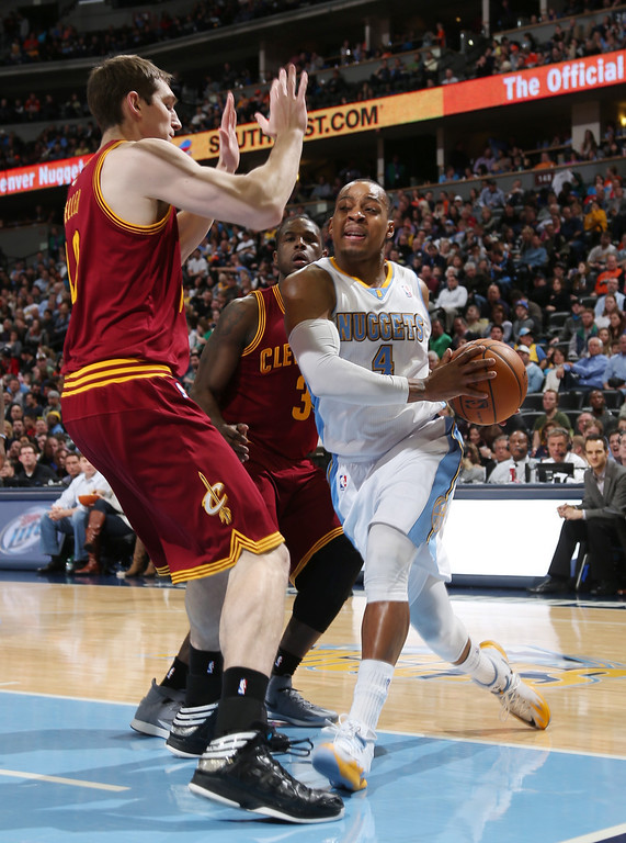 . Denver Nuggets guard Randy Foye, front right, drives for shot as Cleveland Cavaliers center Tyler Zeller, front, left, and guard Dion Waiters covers in the third quarter of the Cavaliers\' 117-109 victory in an NBA basketball game in Denver on Friday, Jan. 17, 2014. (AP Photo/David Zalubowski)