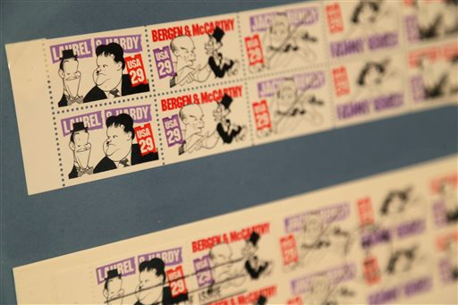 Description of . Stamps with art by Al Hirschfeld are displayed in an exhibit on the artist at the Library for the Performing Arts in New York, Wednesday, Oct. 16, 2013. The exhibit, which opens Thursday, Oct. 17, 2013, showcases work through Hirschfeld's career. (AP Photo/Seth Wenig)