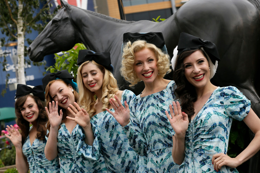 . Racegoers pose for photographers on the second day of the Royal Ascot horse race meeting in Ascot, England, Wednesday, June 20, 2018. (AP Photo/Tim Ireland)