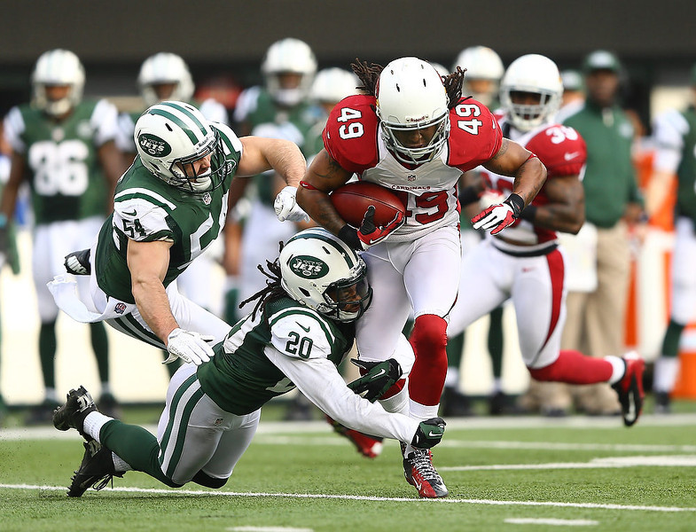 . Rashad Johnson #49 of the Arizona Cardinals gets a first down on a fake punt as  Kyle Wilson #20 of the New York Jets makes the tackle during their game at at MetLife Stadium on December 2, 2012 in East Rutherford, New Jersey.  (Photo by Al Bello/Getty Images)