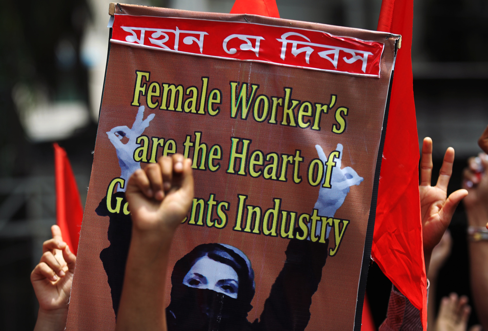 Description of . Protestors shout slogans calling for better working conditions for garment workers during a May Day rally on Wednesday, May 1, 2013, in Dhaka, Bangladesh. Thousands of workers paraded through central Dhaka on May Day to demand safer working conditions and the death penalty for the owner of a building housing garment factories that collapsed last week in the country's worst industrial disaster, killing at least 402 people and injuring 2,500.(AP Photo/Wong Maye-E)