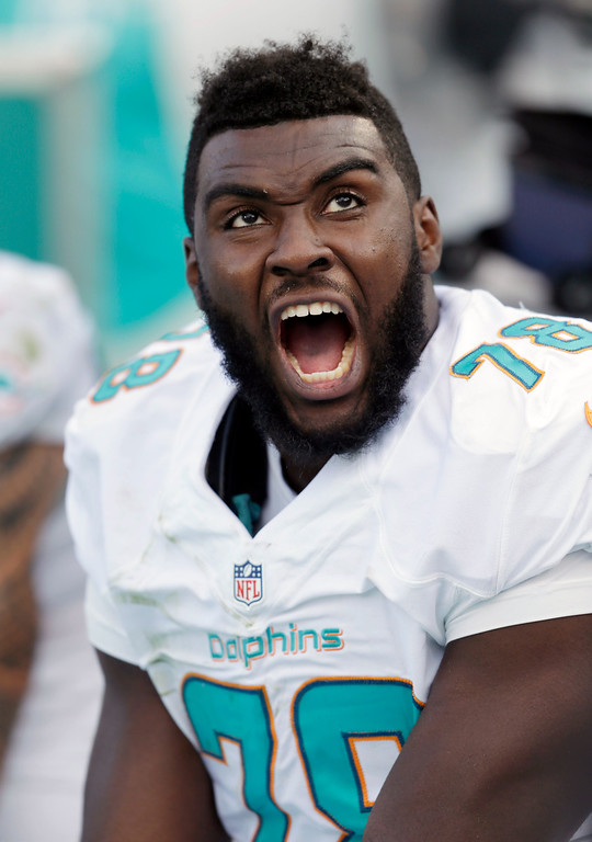 . Miami Dolphins defensive end Terrence Fede reacts from the bench after watching a play during the second half of an NFL football game against the Baltimore Ravens, Sunday, Dec. 7, 2014 in Miami Gardens, Fla. The Ravens defeated the Dolphins 28-13. (AP Photo/Wilfredo Lee)