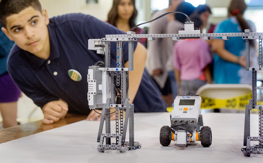 """. Alex Guerra of Emerson Middle School in Pomona has his robot compete in \""""Gatecrasher\"""" which consists of having his robot enter the gate without striking the pillars nearest to 7 seconds in total time.  Guerra robot made it through the gate in 6.857 seconds. Cal Poly Pomona\'s Robotics Initiative invited 200 elementary and middle school students to a Robot Expo at LA Fairplex in Pomona Monday, May 20, 2013. Walnut Valley is sending Collegewood, Evergreen Elementary and Suzanne Middle School to compete.(SGVN/Photo by Walt Mancini)"""