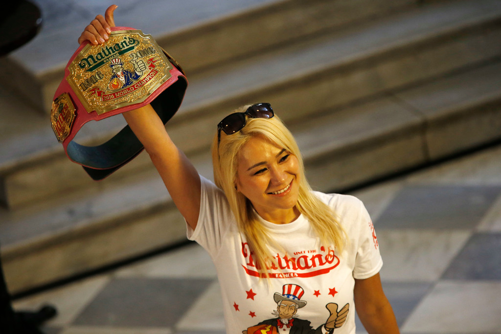 . Miki Sudo, Las Vegas the woman hot dog-eating champion is introduced before taking part in the weight in for the Nathan\'s Famous Hotdog eating contest Monday, July 3, 2017, in Brooklyn, New York. Sudo is defending her title where she ate 38.5 hot dogs and buns in 10 minutes in 2016. (AP Photo/Michael Noble)