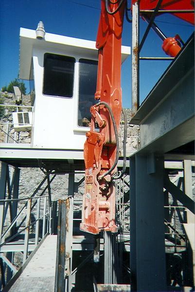 NPK B600 pedestal boom system with E207 hydraulic hammer-breaking bridged rock in quarry (9).jpg