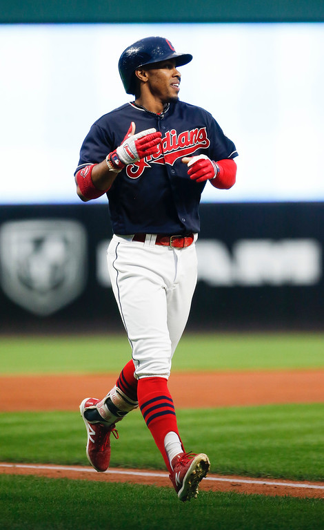 . Cleveland Indians\' Francisco Lindor celebrates after hitting a solo home run of Detroit Tigers starting pitcher Matthew Boyd during the first inning in a baseball game, Tuesday, Sept. 12, 2017, in Cleveland. (AP Photo/Ron Schwane)