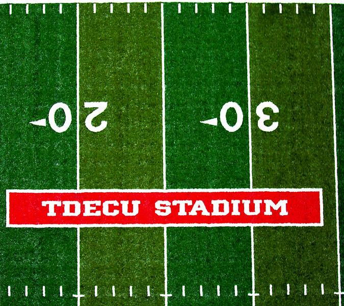 An overhead view of the TDECU Stadium sign on the turf.
