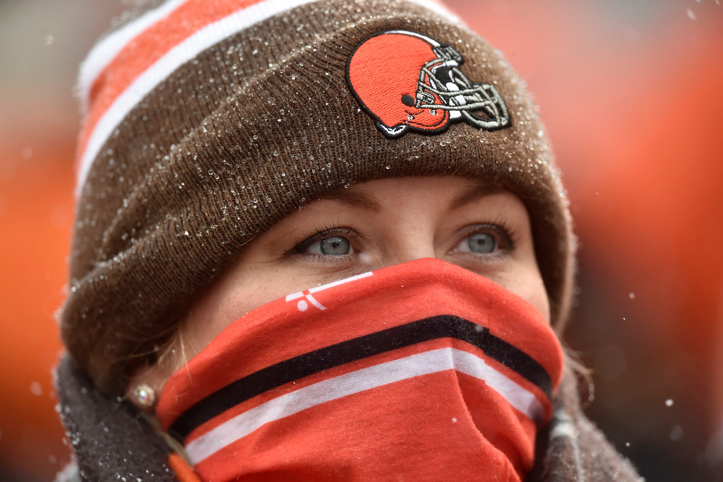 . A Cleveland Browns fan watches in the first half of an NFL football game between the Cincinnati Bengals and the Cleveland Browns, Sunday, Dec. 11, 2016, in Cleveland. (AP Photo/David Richard)