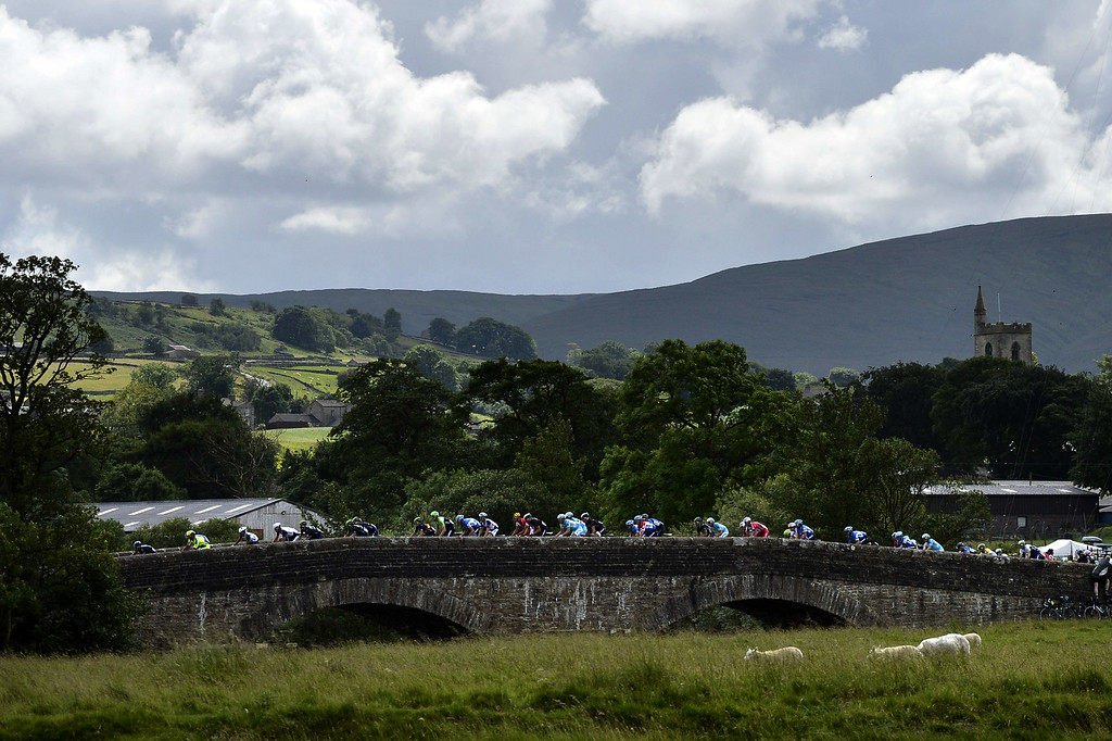 . The pack rides during the 190.5 km first stage of the 101st edition of the Tour de France cycling race on July 5, 2014 between Leeds and Harrogate, northern England.  The 2014 Tour de France gets underway on July 5 in the streets of Leeds and ends on July 27 down the Champs-Elysees in Paris. JEFF PACHOUD/AFP/Getty Images