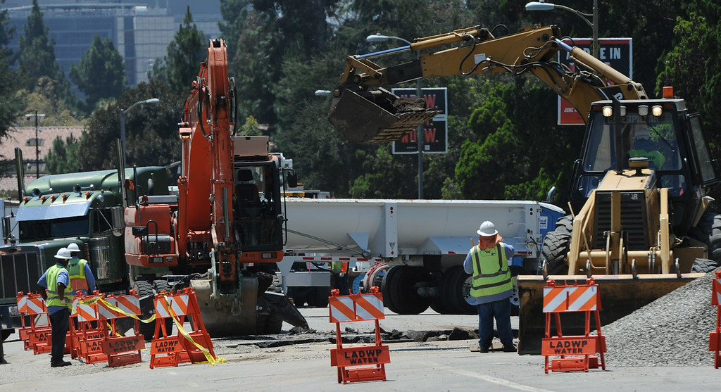 . Work crews on Sunset Blvd. make repairs to the water line that burst open and flooded parts of the UCLA campus. Westwood, CA. 7/31/2014(Photo by John McCoy Daily News)