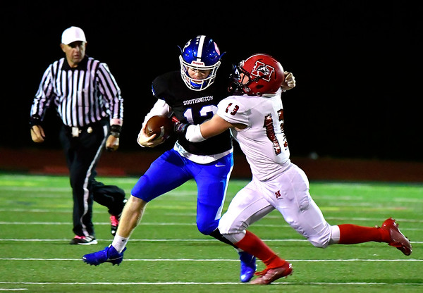 10/11/2019 Mike Orazzi | StaffrSouthington's Shane LaPorte (12) and Machester's Michael Burnes (13) during Friday night's football game in Southington.