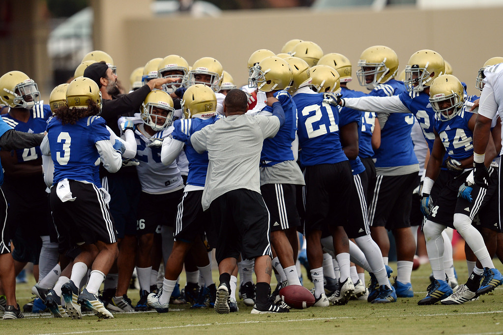 . UCLA players scuffle during football practice at Spaulding Field on the UCLA campus Thursday, April 17, 2014. (Photo by Hans Gutknecht/Los Angeles Daily News)