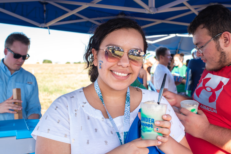 Briannna Saldivar comes out to the Islander's Soccer Tailgate for root-beer floats as she cools off before the Islanders vs. Texas State game at Dugan Stadium