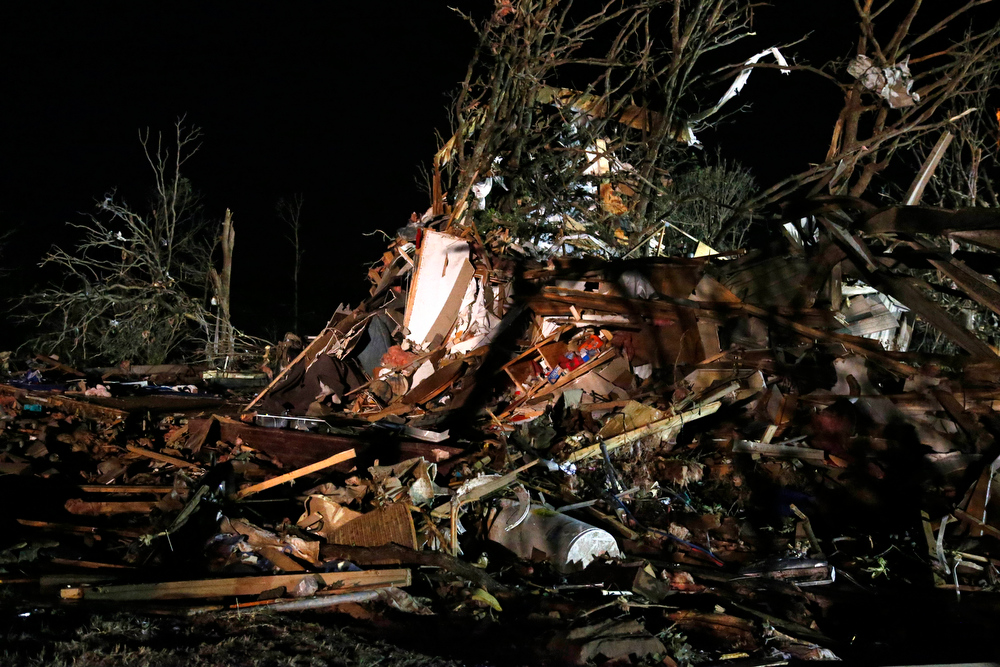 Description of . Debris is scattered in what was a mobile home park where a tornado struck near Dale, Okla., Sunday, May 19, 2013. (AP Photo Sue Ogrocki)