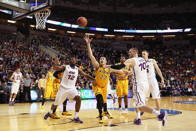 . Marvin Singleton #12 and Seth Tuttle #10 battle for a loose ball against Larry Nance Jr. #22 of the Wyoming Cowboys during the second round of the 2015 Men\'s NCAA Basketball Tournament at KeyArena on March 20, 2015 in Seattle, Washington.  (Photo by Otto Greule Jr/Getty Images)