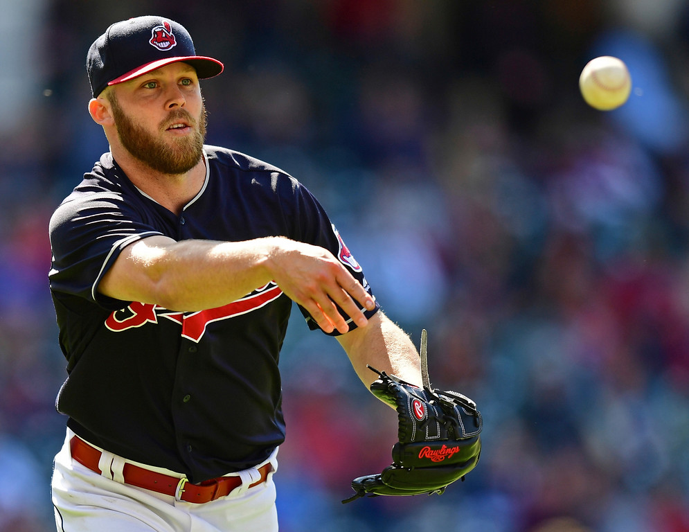 . Cleveland Indians relief pitcher Cody Allen tosses the ball to first base to get out Milwaukee Brewers\' Jonathan Villar in the ninth inning of a baseball game, Wednesday, June 6, 2018, in Cleveland. The Indians won 3-1.(AP Photo/David Dermer)