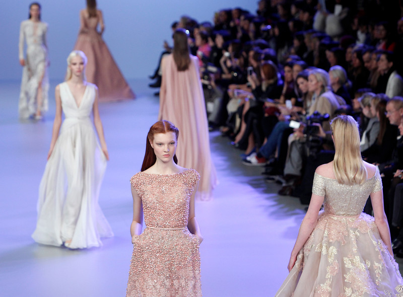 . Models wear creations during Elie Saab\'s Spring-Summer 2014 Haute Couture fashion collection presentation, in Paris, Wednesday, Jan.22, 2014. (AP Photo/Thibault Camus)