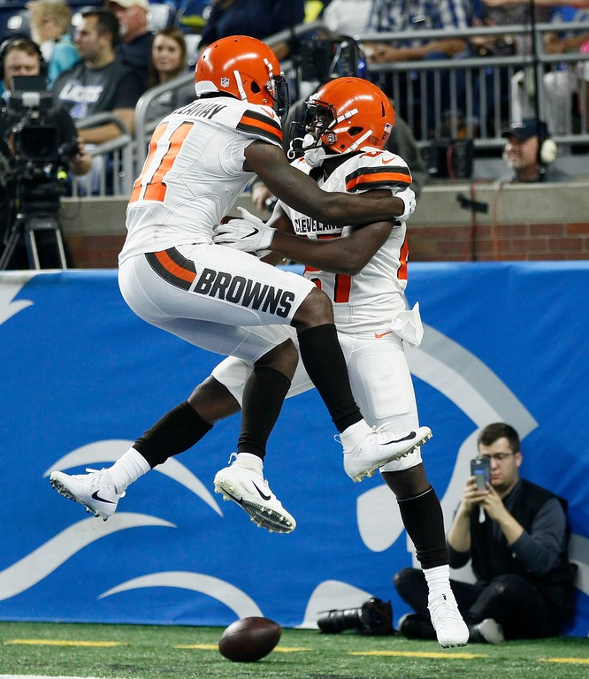 . Cleveland Browns running back Matt Dayes, right, celebrates his 42-yard rushing touchdown with teammate wide receiver Antonio Callaway (11) during the first half of an NFL football preseason game against the Detroit Lions, Thursday, Aug. 30, 2018, in Detroit. (AP Photo/Duane Burleson)