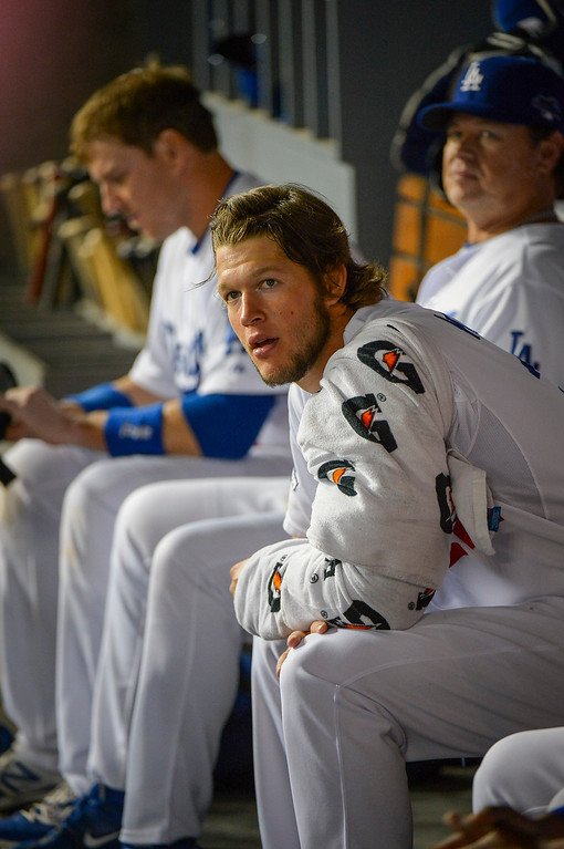 . Dodger\'s Clayton Kershaw rests during game action Monday, October 7, 2013 ( Photo by Andy Holzman/Los Angeles Daily News )