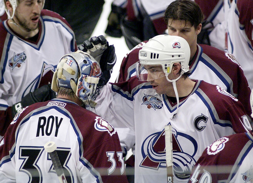 . Joe Sakic congratulates Patrick Roy after the Av\'s defeated the St. Louis Blues at Pepsi Center during the first game of the Western Conference Finals 4-1.  (Andy Cross/The Denver Post)