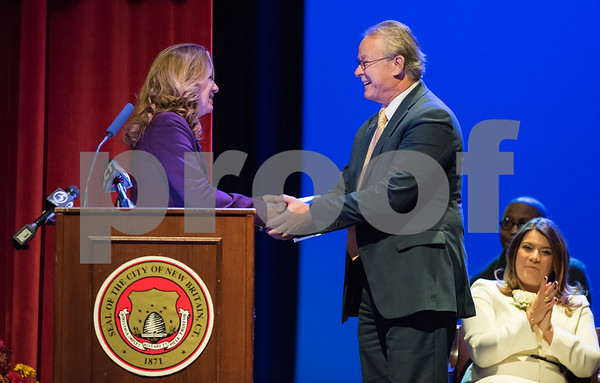 11/14/17 Wesley Bunnell | Staff The inauguration of Mayor Erin E. Stewart and other elected officials was held on Tuesday morning at New Britain High School. Antoinette Spinella, L, shakes hands with Town and City Clerk Mark H. Bernacki after his oath of office.