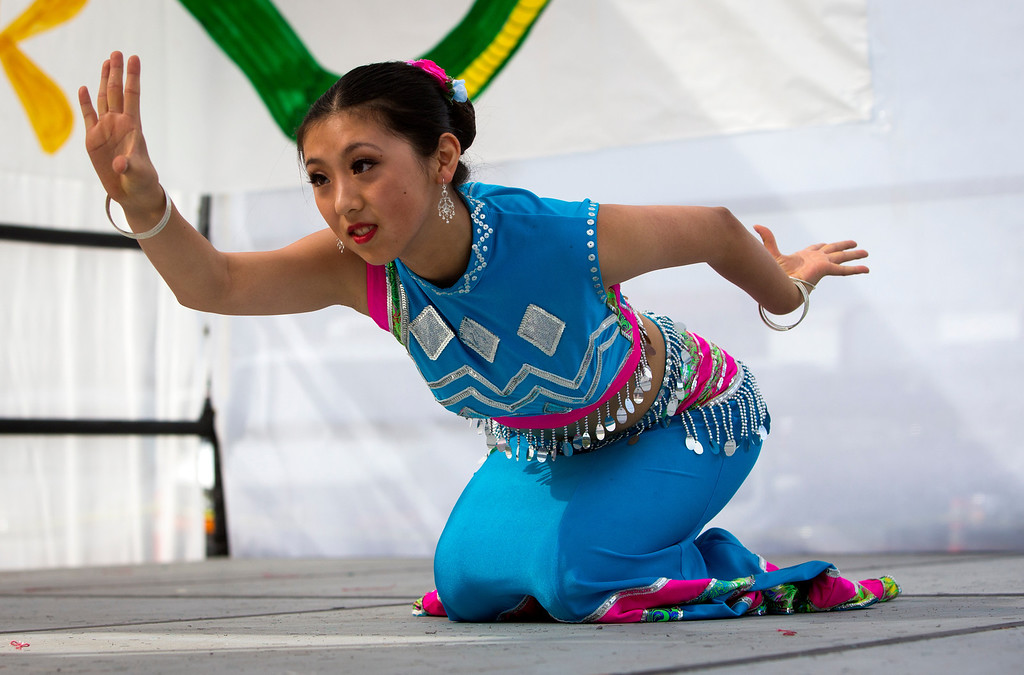 . Irene Wang, 15, performs the snake dance at the Lunar New Year Festival in Millbrae, Calif. on Saturday, Feb. 16, 2013. Festivities included a street festival, a table tennis tournament and dance performances. (John Green/Staff)