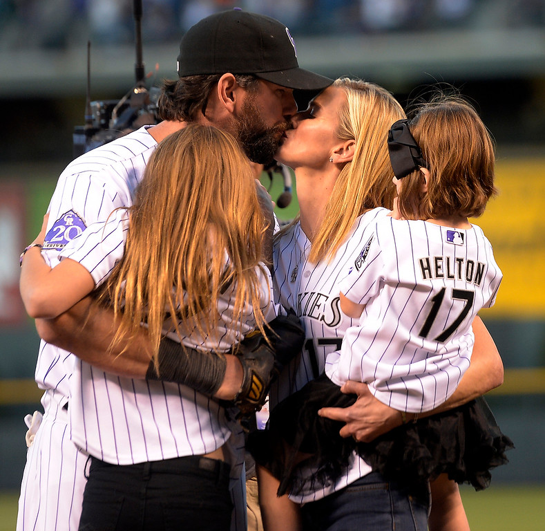 . Todd Helton kisses his wife Christy and their two daughters Tierney Faith, left, and Gentry Grace before the start of action in Denver. The Colorado Rockies hosted the Boston Red Sox and said farewell to longtime first baseman Todd Helton, who recently announced his retirement following this season. (Photo by John Leyba/The Denver Post)
