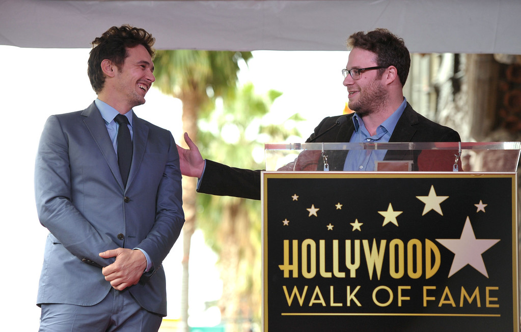 """. Actor James Franco, left, reacts to Seth Rogen\'s remarks at a ceremony honoring Franco with a star on the Hollywood Walk of Fame on Thursday, March 7, 2013 in Los Angeles. Franco and Rogen starred together in the comedy \""""Pineapple Express.\"""" (Photo by John Shearer/Invision/AP)"""