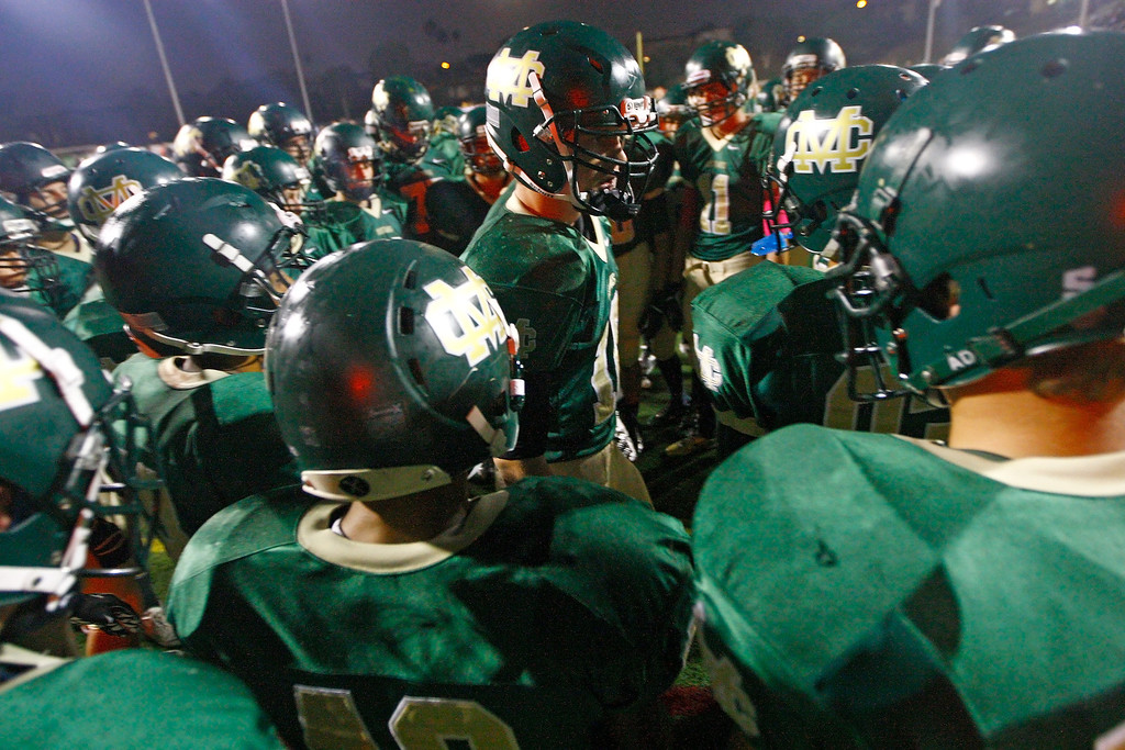 . Dane Largent (center) of Mira Costa gives a pep talk before kickoff against Palos Verdes in a Bay League matchup at Mira Costa High School on Friday, October 18, 2013 in Manhattan Beach, Calif.  (Michael Yanow / For the Daily Breeze)