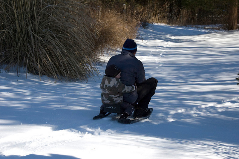 Hang on Jackson.  I'm glad the sled had some steering. They would go down the hill and then make a left turn.