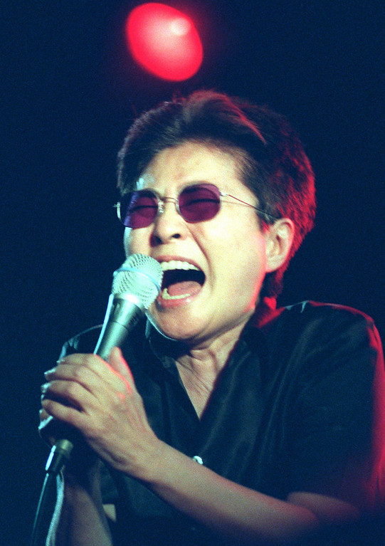 """. Yoko Ono, widow of John Lennon, during her performance in the music hall \""""Loft\"""" in Berlin Monday night, June 3, 1996. The Berlin concert was the start of her tour through Germany. (AP Photo/Hans Edinger)"""