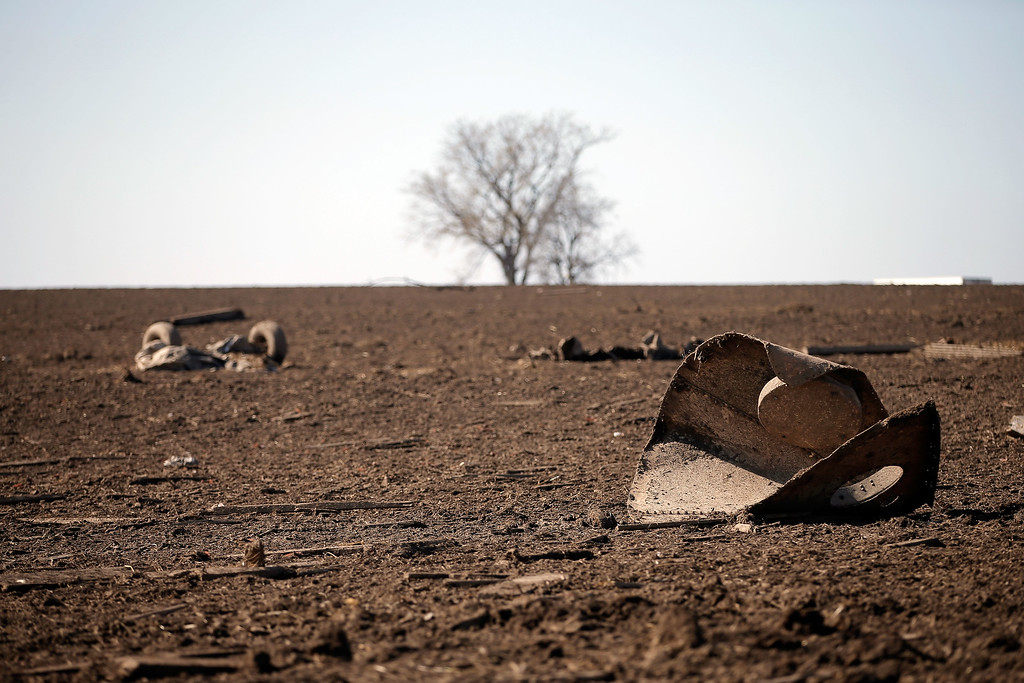 . Debris lay in a field off of IL-64 after a tornado came through the previous night, on April 10, 2015 in Rochelle, Illinois. According to reports, 11 people were injured and one person was killed when tornadoes and thunderstorms passed through the northwestern suburbs of Chicago. (Photo by Jon Durr/Getty Images)