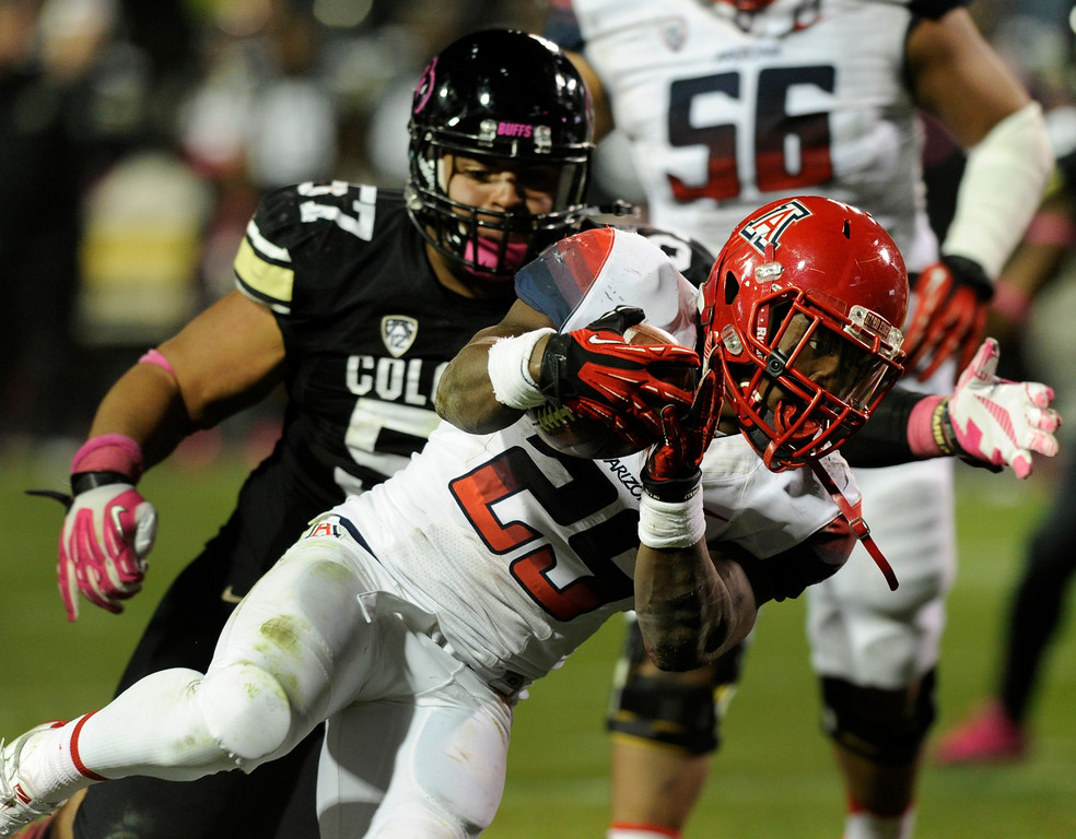 . BOULDER, CO. - OCTOBER 26: Arizona running back Ka\'Deem Carey (25) surged towards the end zone for a touchdown in the second half. The University of Colorado football team hosted Arizona Saturday night, October 26, 2013. Photo By Karl Gehring/The Denver Post