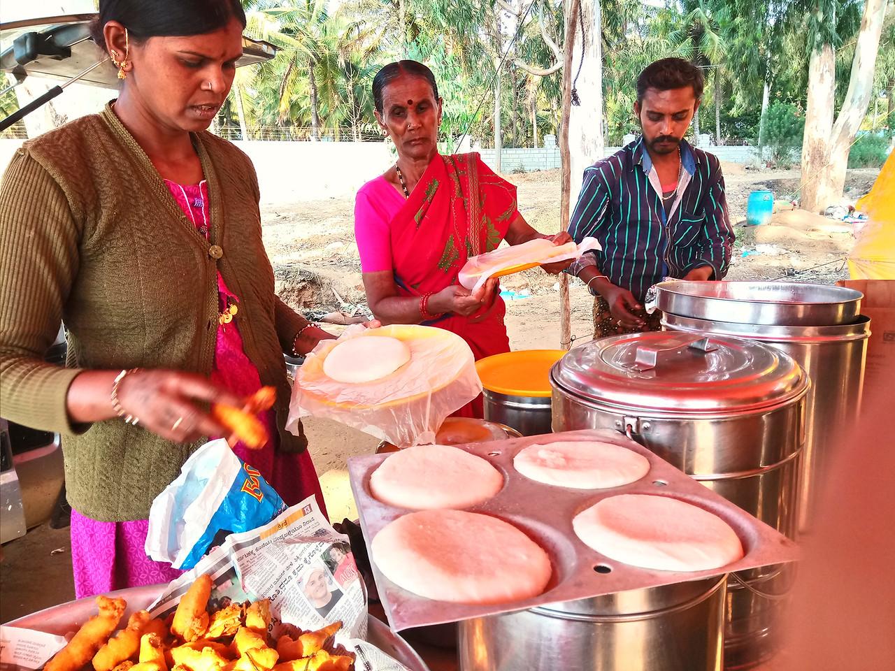 Roadside food stall outside of Bangalore on the Bangalore-Mumbai highway selling fresh idlis and dosas