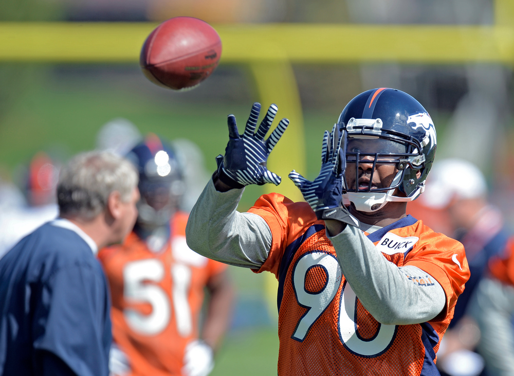 . Shaun Phillips (90) of the Denver Broncos catches a pass during the teams OTAs May 20, 2013 at Dove Valley. All offseason training activities (OTAs) are voluntary until the mandatory minicamp June 11-13. (Photo By John Leyba/The Denver Post)