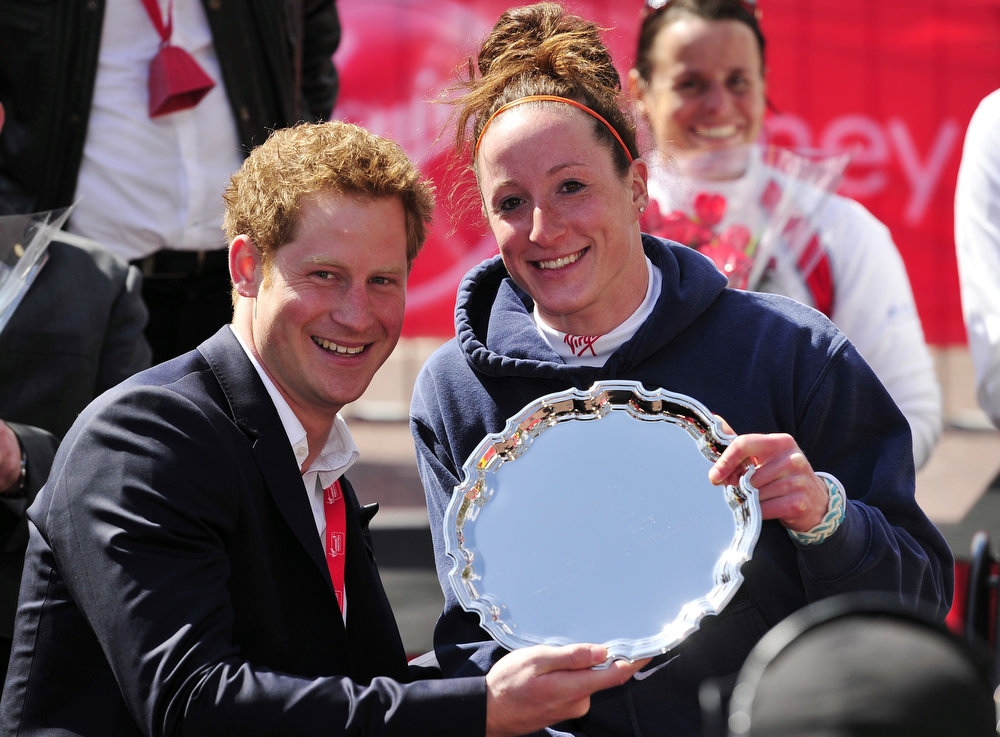 . Tatyana McFadden of the US poses with Britain\'s Prince Harry after winning the women\'s wheelchair race in the 2013 London Marathon in London on April 21, 2013. American Tatyana McFadden claimed victory in the women\'s wheelchair event in a course record time to follow up her success in the equivalent race in Boston. AFP PHOTO / GLYN KIRK