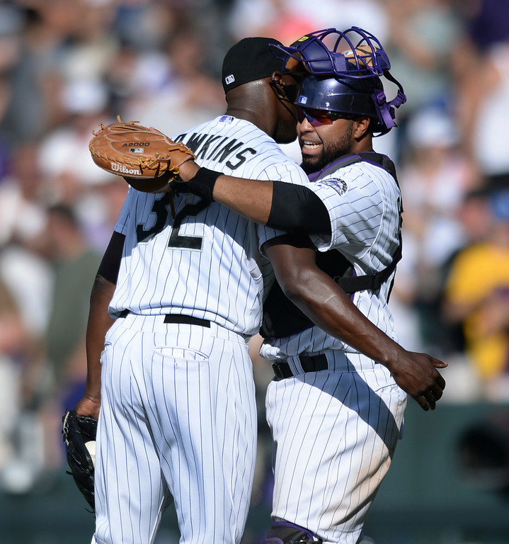. DENVER, CO - JULY 5:  Colorado catcher Wilin Rosario embraced closer LaTroy Hawkins after he pitched the  ninth inning. The Colorado Rockies defeated the Los Angeles Dodgers 8-7 at Coors Field Saturday afternoon, July 5, 2014.  Photo by Karl Gehring/The Denver Post