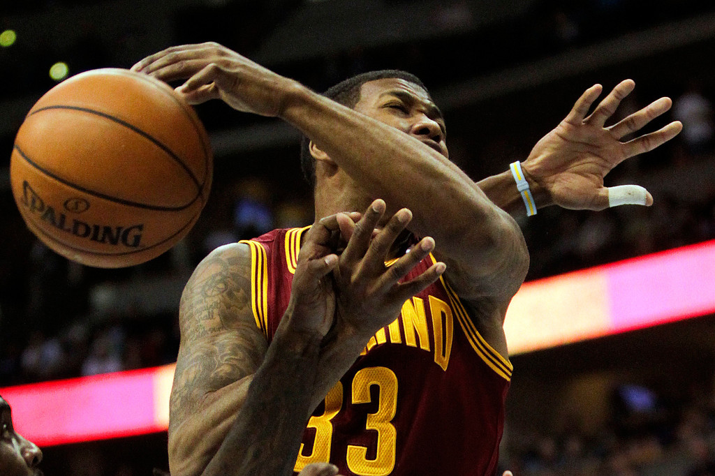 . Cleveland Cavaliers\' Alonzo Gee (33) goes up for a rebound during the fourth quarter of an NBA basketball game against the Denver Nuggets Friday, Jan. 11, 2013, in Denver. The Nuggets won 98-91 (AP Photo/Barry Gutierrez)