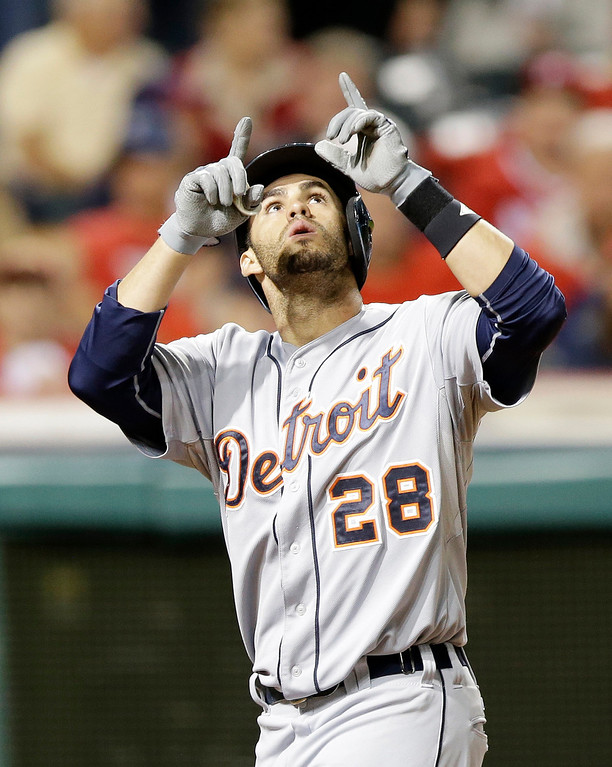 . Detroit Tigers\' J.D. Martinez looks up after hitting a three-run home run off Cleveland Indians relief pitcher John Axford in the eighth inning of a baseball game, Friday, June 20, 2014, in Cleveland. Miguel Cabrera and Victor Martinez scored. (AP Photo/Tony Dejak)