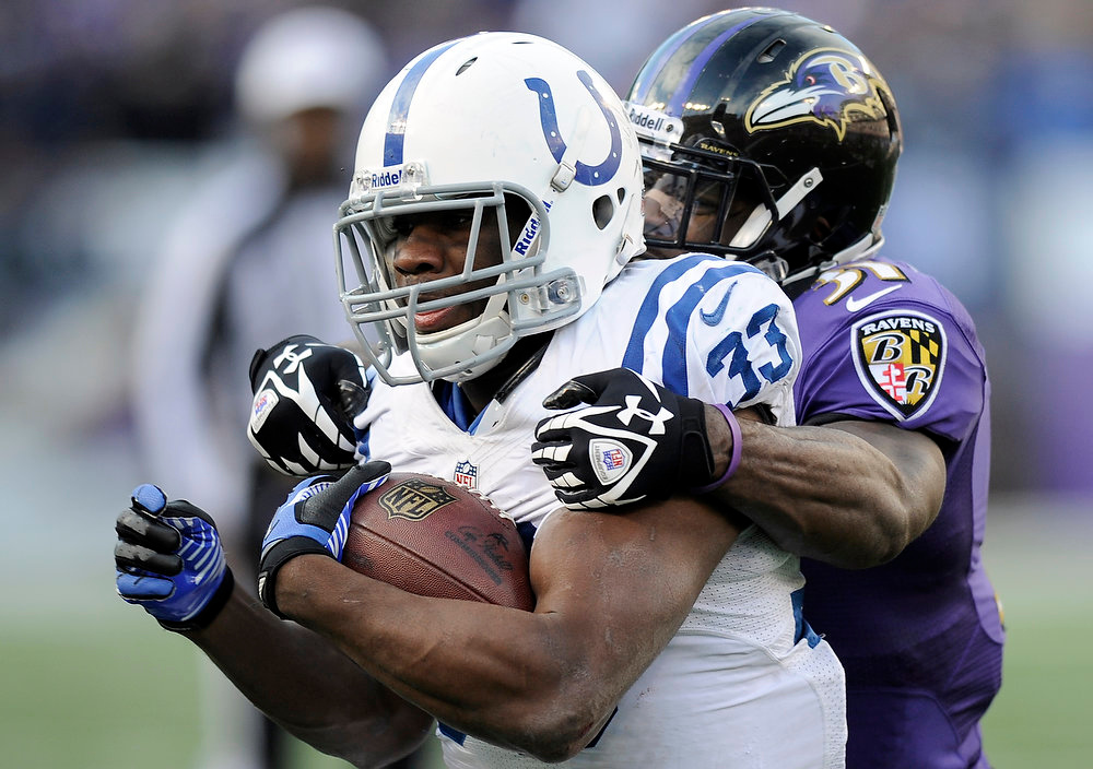 . Indianapolis Colts running back Vick Ballard (33) is hit by Baltimore Ravens strong safety Bernard Pollard (31) during the second half of an NFL wild card playoff football game Sunday, Jan. 6, 2013, in Baltimore. (AP Photo/Nick Wass)